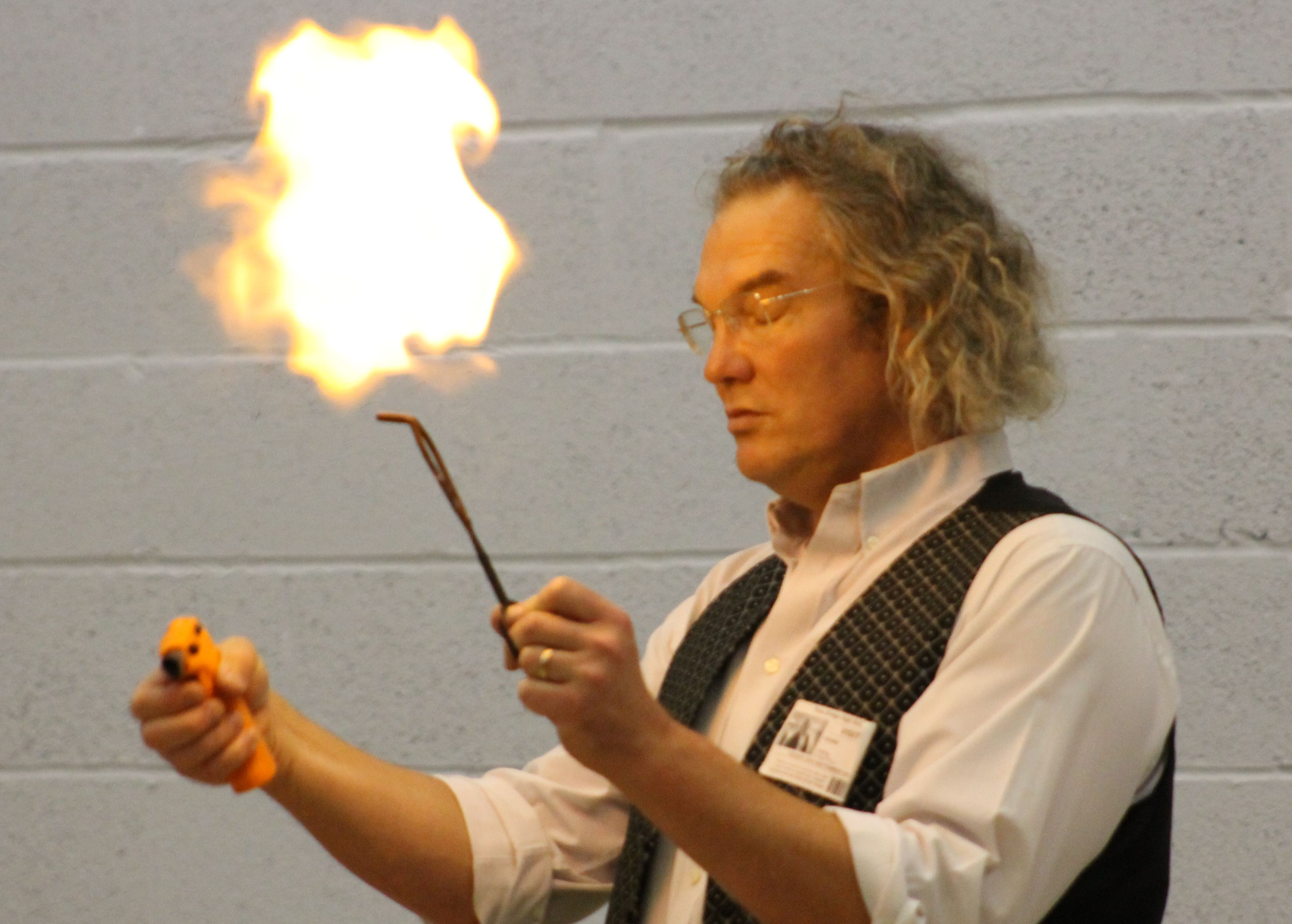 Ian B Dunne playing with fire at a science show